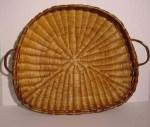 Een wan is een platte mand met twee handvaten.